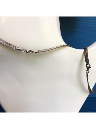 Комплект из серебряных колье и браслета