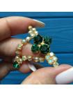 Брошь Aurora Borealis с подвижной цепочкой и с кристаллами цвета изумруд