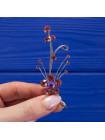 Нежная и легкая брошь, украшенная сверкающими кристаллами цвета аметиста
