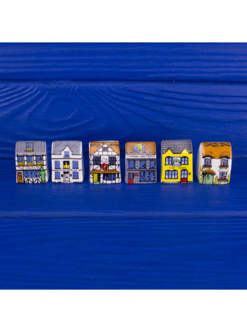 Очаровательные наперстки в форме домиков, из которых можно выстроить целую улицу