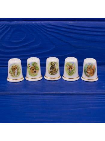 Прелестный комплект из пяти фарфоровых наперстков с животными