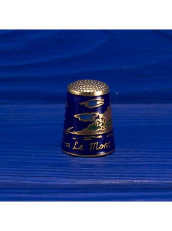 Сувенирный наперсток из Мон-Сен-Мише́ль — небольшого скалистого острова, превращённого в остров-крепость, на северо-западном побережье Франции