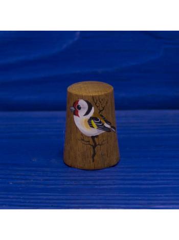 Деревянный наперсток с изображением птицы