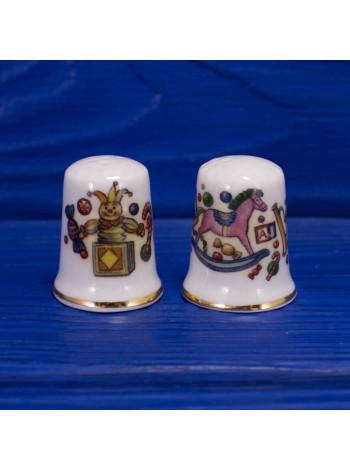 Комплект из двух фарфоровых наперстков с изображением детских игрушек