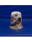 Комплект из четырех нарядных фарфоровых наперстков с птицами